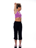 beautiful mature woman on isolated white background doing stretching exercise