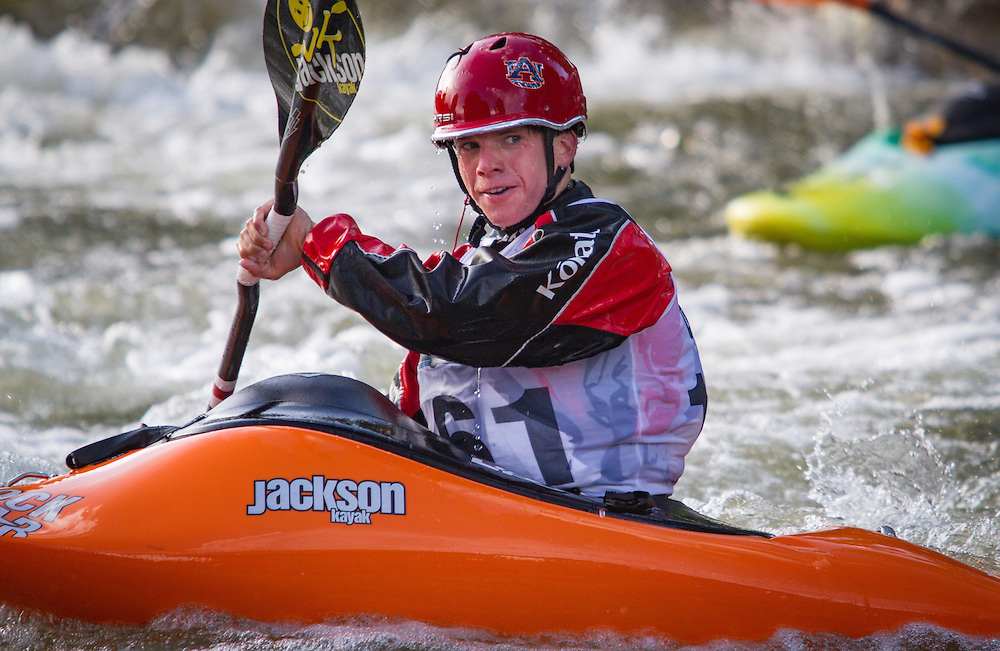 Freestyle kayaker challenges the wave at Salida Boat Ramp in competition during the FibArk whitewater festival.