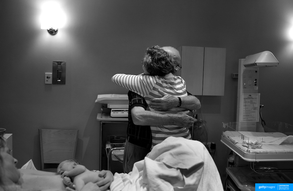 Jen, with baby Luca, as her parents share a moment of celebration in the delivery room in a hospital in Sydney, Australia, on 21st January 2009. Photo by Tim Clayton..