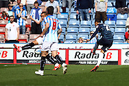 Thomas Ince of Derby County (r)  shoots and scores his teams 1st goal. Skybet football league championship match, Huddersfield Town v Derby county at the John Smith's stadium in Huddersfield, Yorkshire on Saturday 18th April 2015.<br /> pic by Chris Stading, Andrew Orchard sports photography.