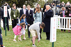 President Donald Trump, with First Lady Melania Trump, son Barron Trump, and daughter Tiffany Trump blows a whistle to begin an Easter Egg Roll race during the 140th Easter Egg Roll on the South Lawn of the White House in Washington, DC on Monday, April 2, 2018. Photo by Olivier Douliery/Abaca Press