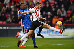 Sheffield United's Jack O'Connell and Bolton Wanderers' Sammy Ameobi battle for the ball