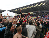 Britannia Stadium  Stoke v Leicester (0-0) Championship 04/05/2008<br /> Liam Lawrence celebrates as fans invade  the pitch as Stoke   are promoted to The Premier League <br /> Photo Roger Parker Fotosports International