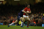 Josh Navidi of Wales is tackled by Tommy Seymour of Scotland. Wales v Scotland, NatWest 6 nations 2018 championship match at the Principality Stadium in Cardiff , South Wales on Saturday 3rd February 2018.<br /> pic by Andrew Orchard, Andrew Orchard sports photography