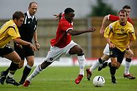 Photo: Marc Atkins.<br />Oxford United v Manchester United XI. Pre Season Friendly. 08/08/2006. Louis Saha (C) of Manchester United breaks away from the Oxford midfield.