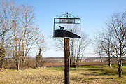 Sign showing horse and ploughman at the rural hamlet of Hoo, Suffolk, England