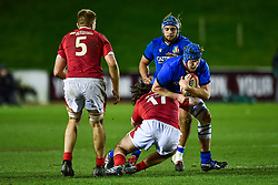Nathaniel Panozzo of Italy is tackled by Theo Bevacqua of Wales <br /> <br /> Photographer Craig Thomas/Replay Images<br /> <br /> U20 Six Nations - Wales v Italy  - Friday 31st January 2020 - Stadiwm Zip World (Parc Eirias) - Colwyn Bay<br /> <br /> World Copyright © Replay Images . All rights reserved. info@replayimages.co.uk - http://replayimages.co.uk