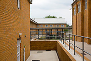 Walkways inside a newly refurbished part of HMP Coldingley. Surrey, United Kingdom. HMP Coldingley is a category C training prison, focussed on the resettlement of prisoners. All inmates must work a full working week, within the prison grounds.