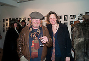 DAVID LITCHFIELD; ARI ASHLEY, The Way We Wore.- Photographs of parties in the 70's by Nick Ashley. Sladmore Contemporary. Bruton Place. London. 13 January 2010. *** Local Caption *** -DO NOT ARCHIVE-© Copyright Photograph by Dafydd Jones. 248 Clapham Rd. London SW9 0PZ. Tel 0207 820 0771. www.dafjones.com.<br /> DAVID LITCHFIELD; ARI ASHLEY, The Way We Wore.- Photographs of parties in the 70's by Nick Ashley. Sladmore Contemporary. Bruton Place. London. 13 January 2010.