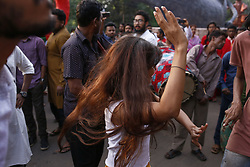 April 13, 2018 - Dhaka, Bangladesh - A girl dances as she participate in a colorful parade to celebrate the first day of the Bengali New year known as Pohela Boishakh in Dhaka. (Credit Image: © Md. Mehedi Hasan via ZUMA Wire)