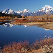 Grand Teton mountain range and the Snake River during autumn in Grand Teton National Park, Wyoming.