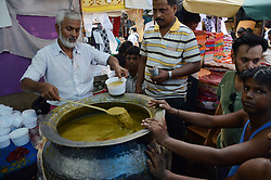 June 17, 2017 - Indian Muslim people buying  food for  Eid ul Fitr festival  in Kolkata, India on Saturday , 17th June , 2017. Muslims around the world are celebrating Eid ul Fitr to mark the end of the holy fasting month of Ramadan  (Credit Image: © Sonali Pal Chaudhury/NurPhoto via ZUMA Press)