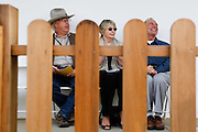From left to right, Roger Skuse, April Halberstadt, and Jim Foran listen to Mayor Jose Esteves talk about the restoration process during the Alviso Adobe Park opening ceremony at Alviso Adobe Park in Milpitas, California, on March 16, 2013. (Stan Olszewski/SOSKIphoto)