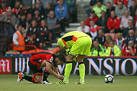 Football - 2016 / 2017 Premier League - AFC Bournemouth vs. Everton<br /> <br /> Bournemouth's Harry Arter ties up Bournemouth's Artur Boruc laces as the can't tie them with his gloves on at Dean Court (The Vitality Stadium) Bournemouth<br /> <br /> Colorsport/Shaun Boggust