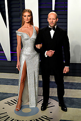 Rosie Huntington-Whiteley (left) and Jason Statham attending the Vanity Fair Oscar Party held at the Wallis Annenberg Center for the Performing Arts in Beverly Hills, Los Angeles, California, USA.
