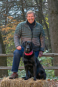 Television host and producer Ron Schara with his famous Labrador Retriever, Raven.