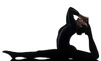 one  woman contortionist Eka Pada Rajakapotasana One Legged King Pigeon Pose yoga in silhouette on white background