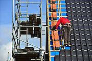 Nederland, Nijmegen, 27-2-2014 Bouwplaats voor huizen in de nieuwe wijk Laauwik, onderdeel van de stadsuitbreiding Waalsprong van Nijmegen in Lent. Er worden hier veel verschillende woningtypen gebouwd, zowel voor sociale huur, koop en vrije sector. isolatie; dakisolatie; isoleren Foto: Flip Franssen/Hollandse Hoogte