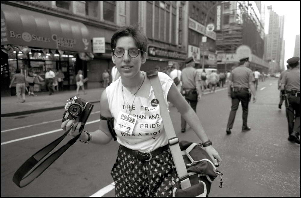 """Ellen Neipris of ACT UP NY, on June 24, 1989, the 20th anniversary of the Stonewall riots, participating in a renegade march up 6th avenue to Central Park. Themed, """"In The Tradition"""", this march followed the same route as the original march 20 years ago and was designed as a rebuke to the corporatization of the gay pride parade."""