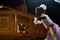 Gros Islet, Saint Lucia: A young dancer performs at Christian revival event on Good Friday.