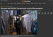 Reuters' featured photos from across the world to mark one year with the Covid-19 pandemic. <br /> <br /> Ki Soon Yi, 71, waits for customers at her dry cleaning business, as businesses struggle with continued work from home protocols, in Philadelphia, Pennsylvania, March 1, 2021. REUTERS/Caroline Gutman
