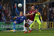 AFC Wimbledon midfielder Mitchell (Mitch) Pinnock (11) trying an overhead kick during the EFL Carabao Cup 2nd round match between AFC Wimbledon and West Ham United at the Cherry Red Records Stadium, Kingston, England on 28 August 2018.