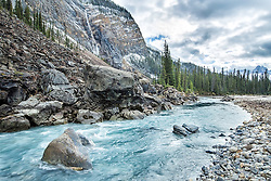 The Yoho River, Takakkaw Falls,  Yoho National Park.  In autumn Canada's tallest waterfall, turns into an unimpressive trickle, however low river flows augment the blues, greens and cyans of the glacier flour laden  waters.