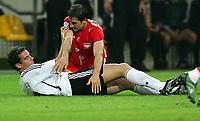 v.l. Christoph Metzelder, Radoslaw Sobolewski Polen oben<br /> Fussball WM 2006 Deutschland - Polen<br /> Tyskland - Polen<br /> Norway only