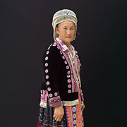 NangTiat 63 an ethnic Hmong woman from Chiang Mai province at Baan Tong Luang, Eco-Agricultural Hill Tribes Village on 7th June 2016 in Chiang Mai province, Thailand. The fabricated village is home to 8 different hill tribes who make a living from selling their handicrafts and having their photos taken by tourists