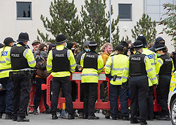 © Licensed to London News Pictures; 20/05/2021; Bristol, UK. Supporters watch from behind barriers as Police and bailiffs evict occupants squatting on the site of a former gas works belonging to Wales and West on Glenfrome Road. The site is occupied by around 75 people including children mostly living in vehicles and caravans.  Bailiffs brought in a crane to lift people off a scaffold tripod blocking the entrance to the site. Police led some occupants away and released them. The site was evicted last year. Photo credit: Simon Chapman/LNP.