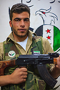 A member of the Free Syrian Army (FSA) holds his personal rifle and pose for a picture at the FSA facilities in Marea on Monday, June 25, 2012. (Photo by Vudi Xhymshiti)