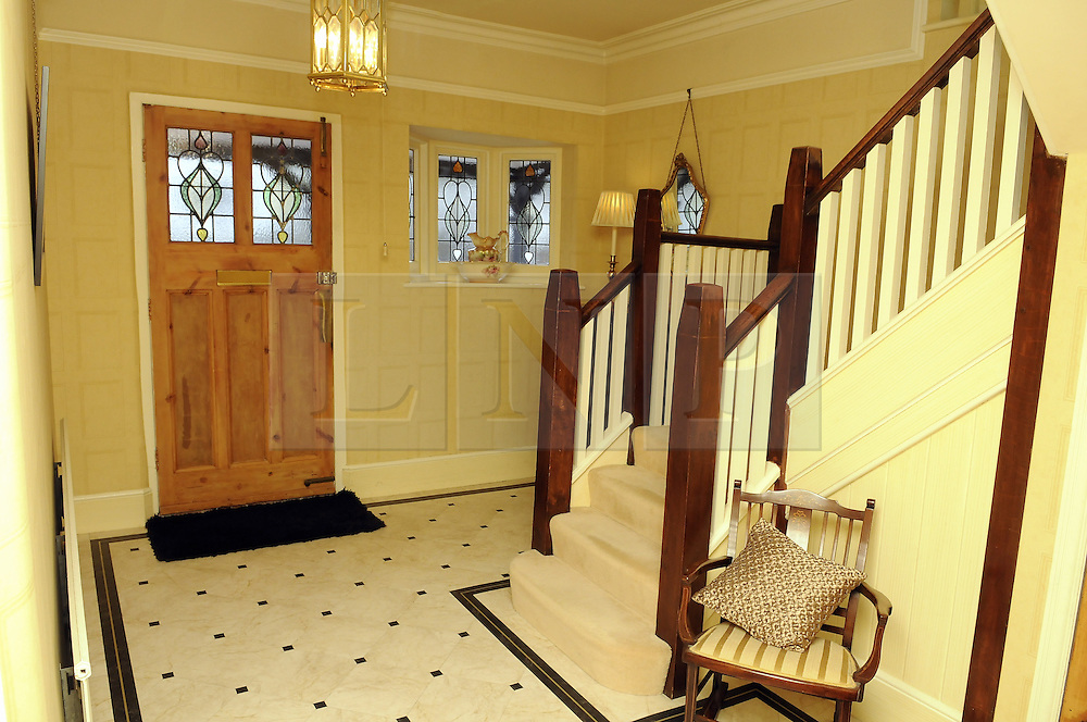 """© Licensed to London News Pictures. 07/01/2012.Hallway..Bromley couple Graham King and Pamela Rutter have decided to give away their house in a Prize Property Competition. Frustrated after months of being unable to sell the family home because of the current economic climate,  Graham and Partner Pamela from Cromwell Avenue in Bromley have set up a website (www.prizeproperty.co.uk) so that people can view the property and purchase tickets for the competition at £30.00 each, people will have to answer three questions about Bromley to enter. The competition which is due to start this week will run until June 29 2012..Mr King needs to sell 25.000 tickets for the prize draw to go ahead. If fewer than 23,400 tickets are sold a cash prize will be given to the winner instead. Mr King a Business Consultant said """"The biggest challenge will be to sell enough tickets""""..Weather Photo credit : Grant Falvey/LNP"""