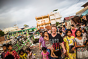 """Scott Neeson, Scottish-Australian film executive turned philanthropist, and Executive Director of the Cambodian Children's Fund engaging with the local community in an impoverished neighbourhood of Phnom Penh - Phnom Penh, Cambodia, May 29th 2015. CREDIT: Christian Berg for The Wall Street Journal - """"Weekend Confidential - Scott Neeson"""""""