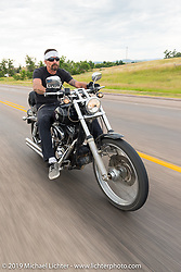 Jeff Marquardt on the annual Michael Lichter - Sugar Bear Ride hosted by Jay Allen from the Easyriders Saloon during the Sturgis Black Hills Motorcycle Rally. SD, USA. Sunday, August 3, 2014.  Photography ©2014 Michael Lichter.