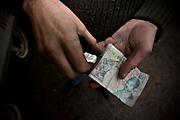 A man with dirty hands counts his money at Take A Break burger van on the 24th February 2010 in Dicklebough in the United Kingdom.