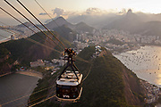 View from Sugar Loaf Mountain at sunset and cable car, Rio de Janeiro.