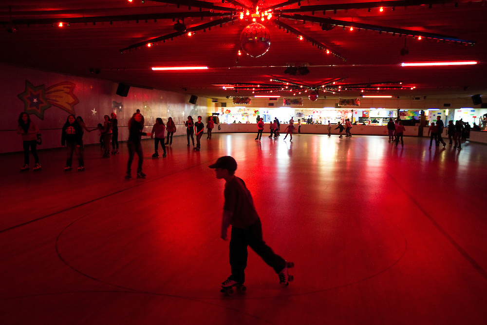 Dozens of skaters circle the floor during Skate Island's 48th annual New Year's Eve party Tuesday night in Grand Island. (Independent/Matt Dixon)