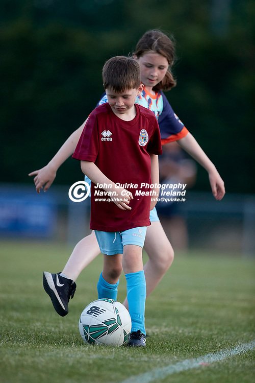 23-07-21, Premier Soccer at Claremont Stadium<br /> Parkvilla v Trim Celtic<br /> Kayla & Ryan Chambers (Flowerhill, Navan) practice their skills in the Claremont goalmouth at halftime in the Premier game between Parkvilla & Trim Celtic<br /> Photo: David Mullen / www.quirke.ie ©John Quirke Photography, Proudstown Road Navan. Co. Meath. 046-9079044 / 087-2579454.<br /> ISO: 1600; Shutter: 1/1250; Aperture: 4;