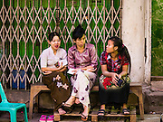 08 NOVEMBER 2015 - YANGON, MYANMAR: Women wait for their polling place in central Yangon to open Sunday. The citizens of Myanmar went to the polls Sunday to vote in the most democratic elections since 1990. The National League for Democracy, (NLD) the party of Aung San Suu Kyi is widely expected to get the most votes in the election, but it is not certain if they will get enough votes to secure an outright victory. The polls opened at 6AM. In Yangon, some voters started lining up at 4AM and lines were reported to long in many polling stations in Myanmar's largest city.      PHOTO BY JACK KURTZ