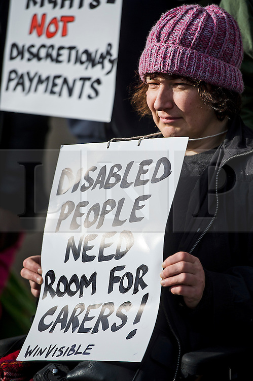 © Licensed to London News Pictures. 29/02/2016. London, UK.  Wheelchair bound campaigner CLAIRE GASMAN joins other Campaigner outside the Supreme Court in London where Justices are due to hear appeals against the under occupancy subsidy, also known as the bedroom tax.  Campaigners believe the reduction in benefits for people in a housing association property that has one or more spare bedrooms, is having a devastating impact on vulnerable people.  Photo credit: Ben Cawthra/LNP