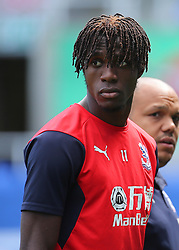 """Crystal Palaces Wilfried Zaha inspects the Madejski Stadium pitch during the pre-season friendly match at the Madejski Stadium, Reading. PRESS ASSOCIATION Photo. Picture date: Saturday July 28, 2018. See PA story SOCCER Reading. Photo credit should read: Mark Kerton/PA Wire. RESTRICTIONS: EDITORIAL USE ONLY No use with unauthorised audio, video, data, fixture lists, club/league logos or """"live"""" services. Online in-match use limited to 75 images, no video emulation. No use in betting, games or single club/league/player publications."""