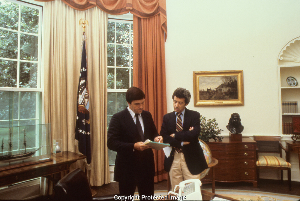 Carter presidential staff members Hamilton Jordan and Jerry Rafshoon in the Oval Office in July 1979<br /> <br /> Photograph by Dennis Brack<br /> bb45
