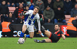 Brighton & Hove Albion's Solly March (left) is fouled by Bournemouth's Steve Cook and received a yellow card during the Emirates FA Cup, third round match at the Vitality Stadium, Bournemouth.