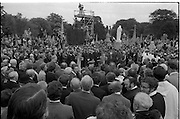 Funeral of Eamon DeValera.   (J72)..1975..02.09.1975..09.02.1975..2nd September 1975..Today saw the funeral of Eamon DeValera. He was laid to rest beside his wife Sinead in Glasnevin Cemetery,Dublin. Dignitries from all around the world attended at the funeral..A general view of the cemetery showing the massive crowd.