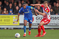 AFC Wimbledon attacker Michael Folivi (41) taking on Doncaster Rovers defender Andy (Andrew) Butler (6) during the EFL Sky Bet League 1 match between AFC Wimbledon and Doncaster Rovers at the Cherry Red Records Stadium, Kingston, England on 9 March 2019.