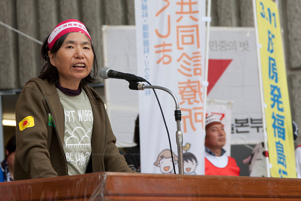 Sachiko Sato of the anti nuclear Fukushima mothers group talks during a left wing rally at the open air stage in Hibiya Park, Tokyo, Japan. Sunday November 3rd  2013