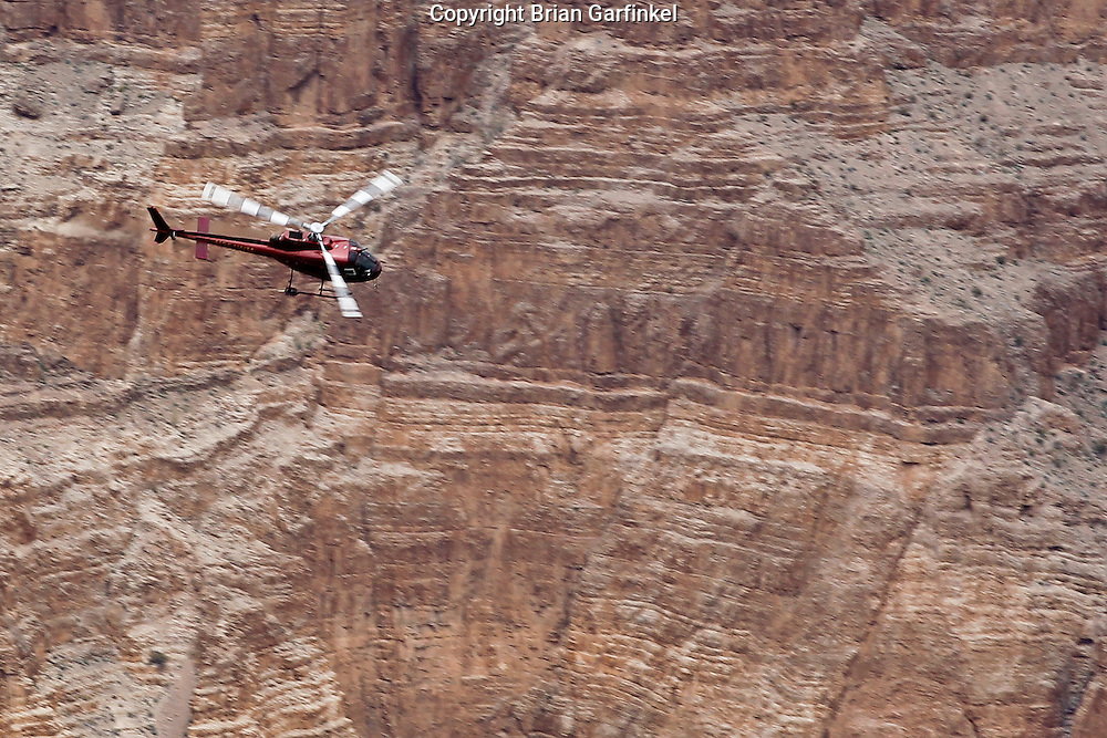A Helicopter flies through The Grand Canyon in Arizona on March 26th 2011. (Photo By Brian Garfinkel)