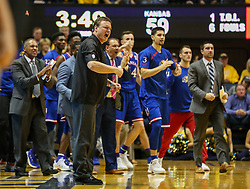 Jan 15, 2018; Morgantown, WV, USA; Kansas Jayhawks head coach Bill Self and the bench reacts after a made basket during the second half against the West Virginia Mountaineers at WVU Coliseum. Mandatory Credit: Ben Queen-USA TODAY Sports