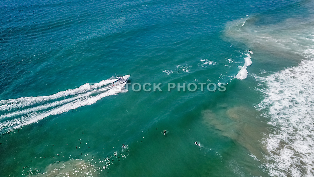 Police Rescue Boat Harassing Surfers Trying to Clear Out the Beach in Huntington Beach