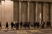 Rush-hour commuters wait for buses in Threadneedle Street, beneath the walls and columns of the Bank of England in the Square Mile, the heart of the capital's historical financial district, on 2nd October 2017, in the City of London, England.